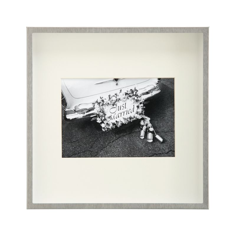 Showcase a photo in contemporary brushed stainless steel. Deep shadow box frames a beveled off-white mat, oversized for dramatic effect. Square frame can be displayed on the wall or freestanding.<br /><br /><NEWTAG/><ul><li>Brushed stainless steel</li><li>Off-white mat</li><li>MDF backboard</li><li>Square frame has easel back</li><li>Made in Taiwan</li></ul>
