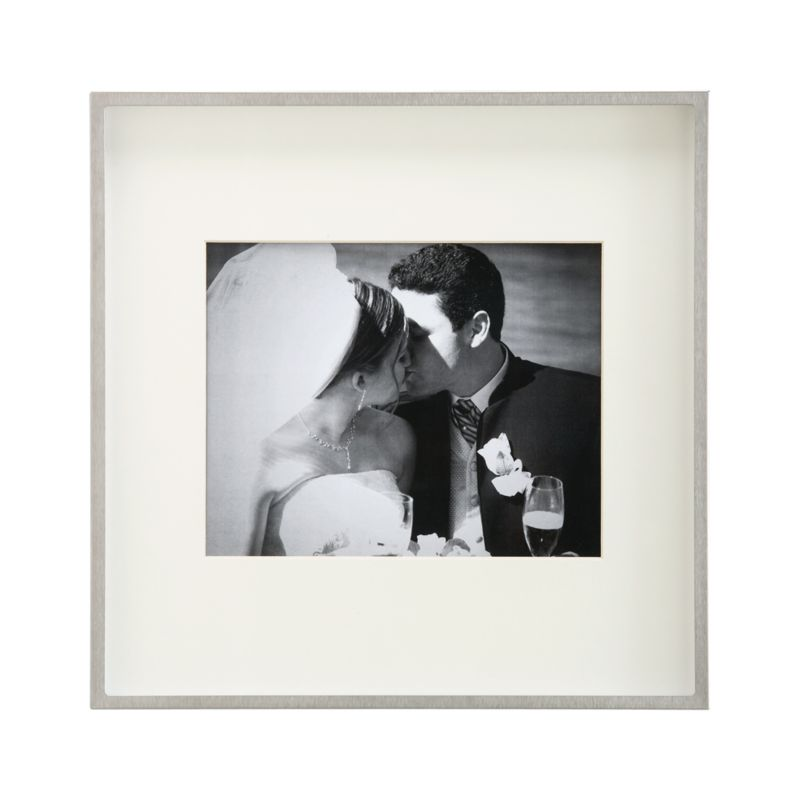 Showcase a photo in contemporary brushed stainless steel. Deep shadow box frames a beveled off-white mat, oversized for dramatic effect. Square frame can be displayed on the wall or freestanding.<br /><br /><NEWTAG/><ul><li>Brushed stainless steel</li><li>Off-white mat</li><li>Square frame has easel back</li><li>Made in Taiwan</li></ul>