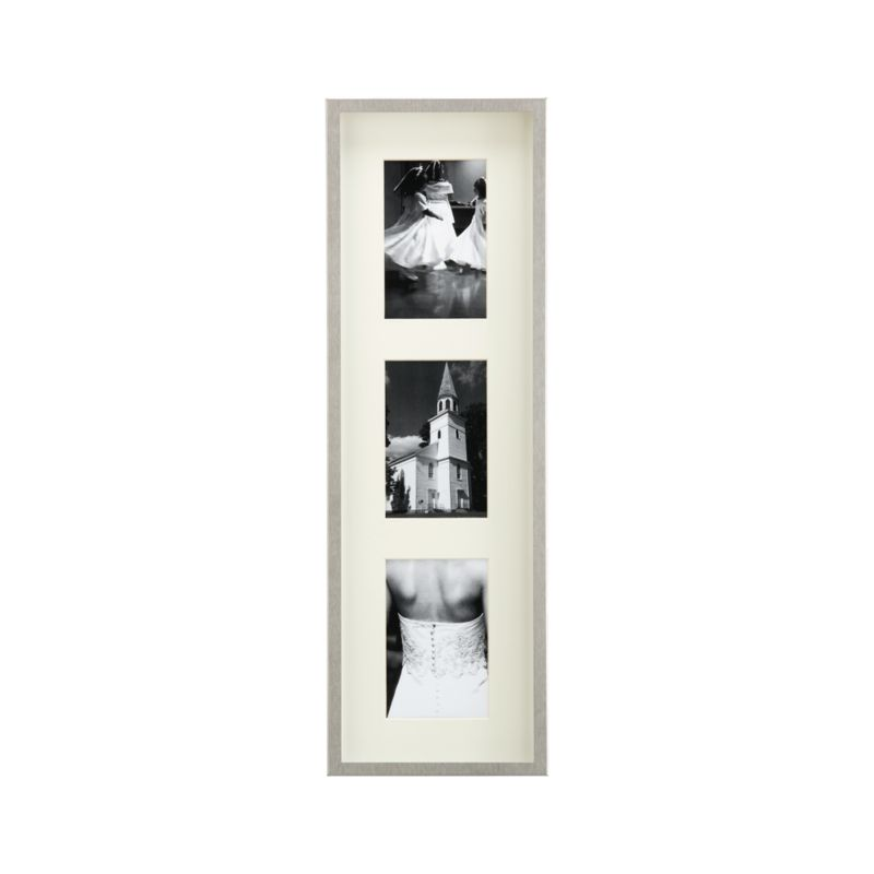 Showcase photos in contemporary brushed stainless steel. Deep shadow box frames a beveled off-white mat, oversized for dramatic effect. Triple frame hangs vertically or horizontally.<br /><br /><NEWTAG/><ul><li>Brushed stainless steel</li><li>Off-white mat</li><li>Made in Taiwan</li></ul><br />