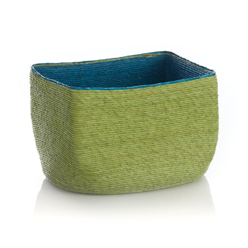 Handwoven by a community of artisans who have supplied us with great products for years, this slim, contemporary basket combines springy shades of blue and green in a tight weave of tropical palm fiber. Striking and colorful basket organizes accessories or keepsakes while adding a pop of rich color to the room.<br /><br /><NEWTAG/><ul><li>Handcrafted</li><li>Palm fiber and string</li><li>Clean with soft cloth</li><li>Made in Mexico</li></ul>