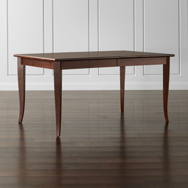 """The bold grain of solid mango wood takes a refined turn in the honey-stained Cabria collection. This traditionally minded extension dining table offers casual-to-formal functionality at an affordable price. <NEWTAG/><ul><li>Sustainable solid mango wood</li><li>Honey brown stain with clear protective lacquer finish</li><li>Seats 6; 8 with 18"""" leaf</li><li>Made in Indonesia</li></ul><br />"""
