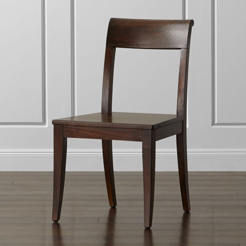 With a clean, edited profile and comfortably curved back, our traditionally minded Cabria side chair complements the extension dining table with its casual-to-formal functionality at an affordable price. The bold grain of solid mango wood takes a refined turn with a rich honey stain showcasing the distinctive ribboning and knotting. <NEWTAG/><ul><li>Sustainable solid mango wood</li><li>Honey brown stain with clear protective lacquer finish</li><li>Floor glides</li><li>Made in Indonesia</li></ul>