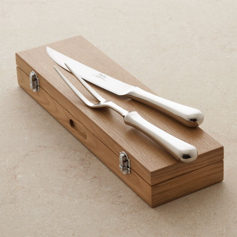 Classically designed carving set with attractive, bright mirror finish compliments any table setting. Knife and long-tined fork are well balanced and comfortable in hand and come packaged in a handsome wood storage box.<br /><br /><NEWTAG/><ul><li>18/10 stainless steel</li><li>Wood storage box</li><li>Dishwasher-safe</li><li>Made in Taiwan</li></ul>