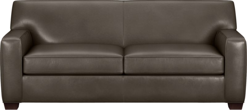 The classic modern leather sofa we've all been looking for in the richest, most supple leather there is—clean-lined but not too edgy, graceful but never fussy. Top-grain Italian hide is aniline-dyed and hand-stained to a handsome tonal effect that only gets more lustrous with time. Natural pebble grain is beautifully showcased by impeccable tailoring with self-welt detail. Perfectly scaled to fit smaller spaces, wide track arms frame plush, generous seat cushions that sink deep into a comfortably angled tight back. Hardwood legs are stained black walnut.<br /><br />After you place your order, we will send a leather swatch via next day air for your final approval. We will contact you to verify both your receipt and approval of the leather swatch before finalizing your order.<br /><br /><NEWTAG/><ul><li>Eco-friendly construction</li><li>Certified sustainable kiln-dried hardwood frame</li><li>Seat cushions are soy-based polyfoam wrapped in regenerated synthetic