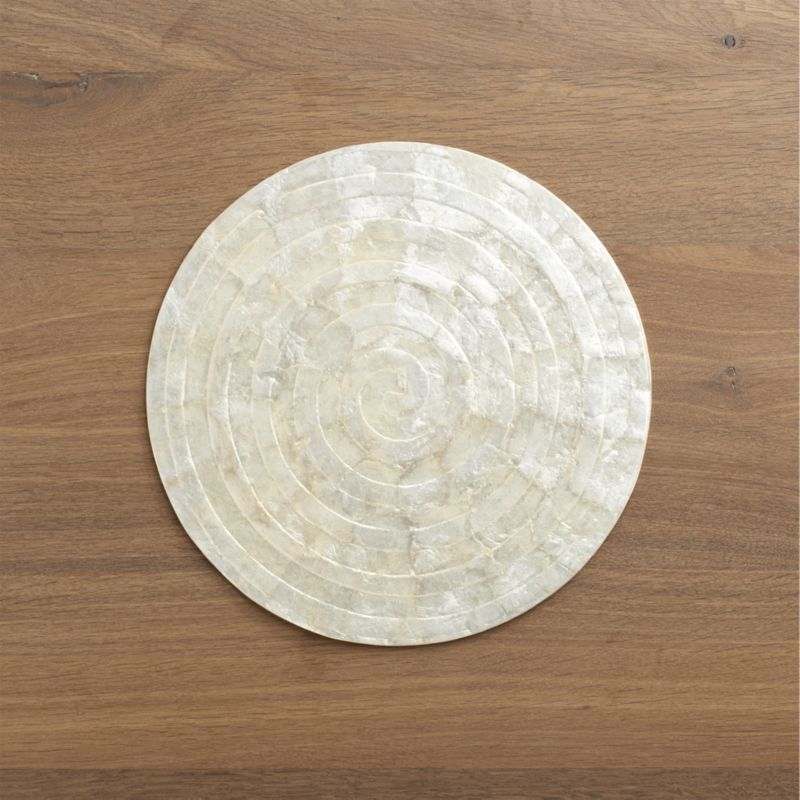 The delicate beauty of capiz shell, crafted in a textured round with natural iridescence.<br /><br /><NEWTAG/><ul><li>100% capiz shell</li><li>Clean placemat with a damp cloth</li><li>Made in Indonesia</li></ul>