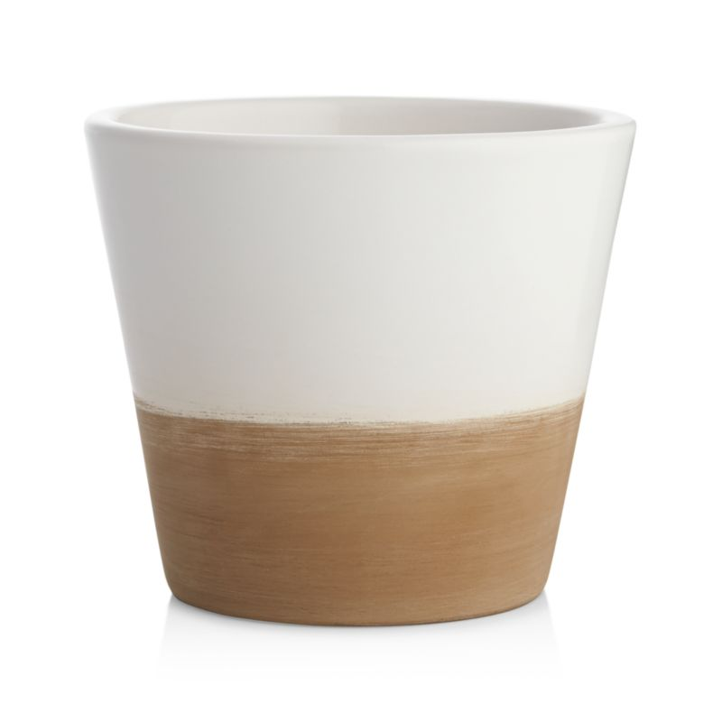 Two-tone earthenware planters cache small pots of herbs or small flowers in garden-party brights with contrasting neutrals.<br /><br /><NEWTAG/><ul><li>Glazed earthenware</li><li>For indoor or outdoor use</li><li>Does not have drainage hole</li><li>Bring indoors during freezing temperatures</li><li>Made in Portugal</li></ul>