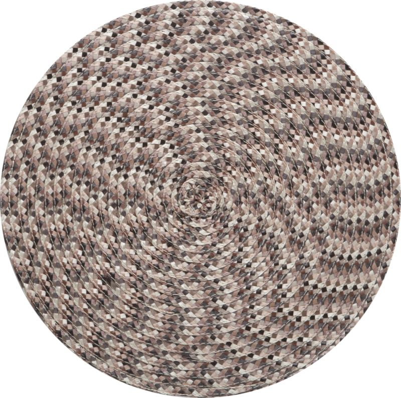 A small check of woven neutrals is embroidered in concentric circles, creating a vibrant optic pinwheel. Modern round mat is easy-care polypropylene.<br /><br /><NEWTAG/><ul><li>Embroidered polypropylene</li><li>Clean with a damp cloth</li><li>Made in China</li></ul>