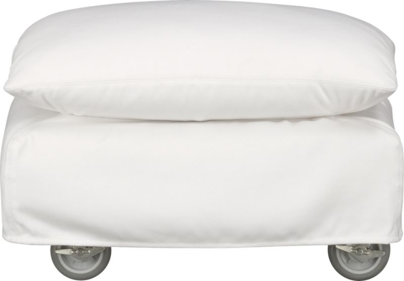 This sleek white slipcovered ottoman looks like it could be right at home in a modern urban loft. But don't bother to come inside—our eco-friendly Catalina collection is designed to live carefree outdoors under blue skies. Under that UV-, fade- and moisture-resistant Sunbrella® sailcloth slipcover (yes, it's even machine-washable), you'll find a thoughtfully crafted chair with a 15-ply outdoor-grade sustainable birch plywood frame made in the USA at the same furniture workshop as many of our living room upholstered collections. Plush cushion is a reticulated open-cell foam that allows water to drain. Upholstered in Sunbrella base cloth sand, an open-weave fabric that accelerates drainage and allows cushion to breath, with a bottom zipper to drain water and release moisture. Four rust-resistant galvanized steel casters allow for effortless seating rearrangements or for moving indoors out of season.<br /><br />After you place your order, we will send a fabric swatch via next day air for your final approval. We will contact you to verify both your receipt and approv