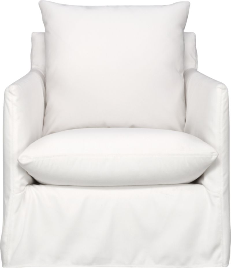 This sleek white slipcovered chair looks like it could be right at home in a modern urban loft. But don't bother to come inside—our eco-friendly Catalina collection is designed to live carefree outdoors under blue skies. Under that UV-, fade- and moisture-resistant Sunbrella® sailcloth slipcover (yes, it's even machine-washable), you'll find a thoughtfully crafted chair made in the USA at the same furniture workshop as many of our living room upholstered collections. A 15-ply outdoor-grade sustainable birch plywood frame subtly slopes the seat deck front to back to drain water properly from an open bottom slot. Plush cushions are a reticulated open-cell foam that allows water to drain. Comfortable back cushion is protected by waterproof ticking. Upholstered in Sunbrella base cloth sand, an open-weave fabric that accelerates drainage and allows cushions and pillows to breath, with a bottom zipper to drain water and release moisture. Swivel action rotates 360 degrees.<br /><br />After you place your order, we will send a fabric swatch via next day air for your final approval. We will contact you to verify both your receipt and approval of the fabric swatch before finalizing your order.<br /><br /><NEWTAG/><ul><li>Eco-friendly construction</li><li>Outdoor-grade sustainable birch plywood frame</li><li>Seat cushion is are mildew-resistant, reticulated open-cell foam</li><li>Back cushion is filled with outdoor recycled fiber in a waterproof ticking</li><li>Slipcovered in 100% Sunbrella solution-dyed acrylic</li><li>Mach