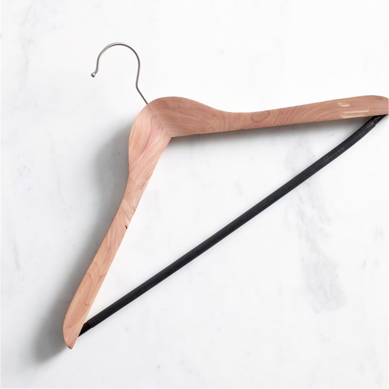 Aromatic, American-grown cedar with its natural moth- and mildew-inhibiting properties refreshes your closet the natural way. Traditional contoured hanger is outfitted with a nonslip textured plastic bar and convenient satin-finish swivel hook. Replacing your mismatched hangers creates a clean, cohesive look for a closet you can take pride in. A light, occasional sanding refreshes the scent, or you can apply cedar oil to enhance the cedar aroma.<br /><br /><NEWTAG/><ul><li>Natural cedar wood with textured plastic bar</li><li>Satin iron swivel hook</li><li>Clean with a damp cloth</li></ul>