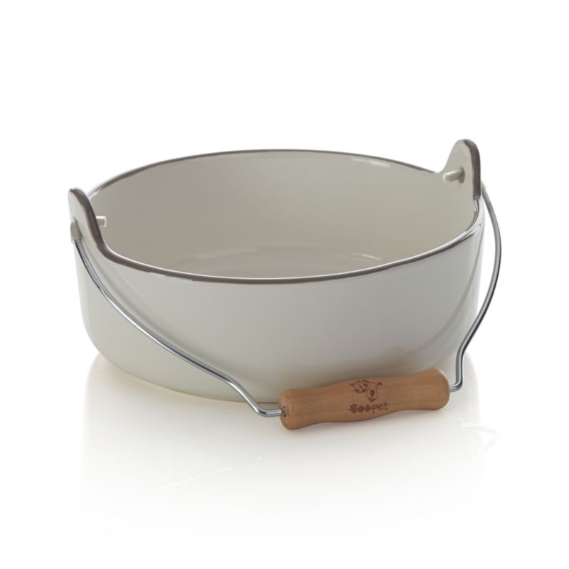 Creamy stoneware bowl and a big wooden handle bring rustic farmhouse charm to your pet's feeding time. Unique to most pet bowls, a handle allows you to easily hoist bowls up for filling and transport them to your hungry animal companion. Holds up to four cups of food or water.<br /><br /><NEWTAG/><ul><li>Stoneware</li><li>Metal and wood handle</li><li>Dishwasher- and food-safe</li><li>Made in China</li></ul>