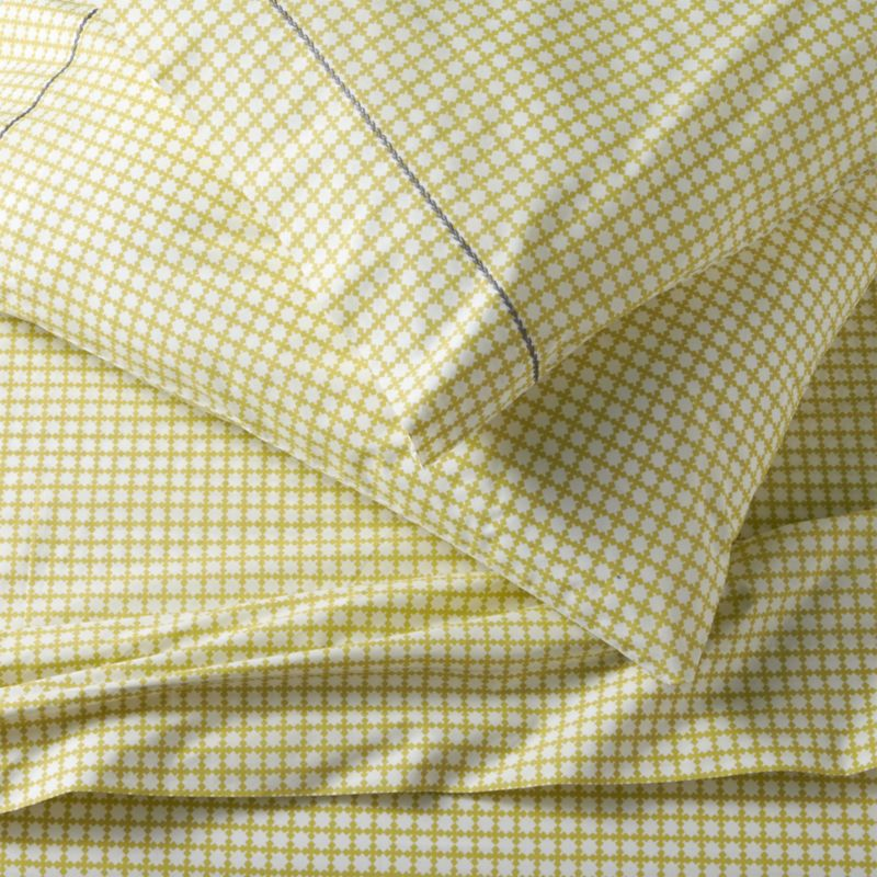 Evocative of bamboo screens, soft focus grid of four-leaf forms is screen-printed on soft cotton percale for an understated look that coordinates well with prints and solids. Pillowcases are embellished with single row of hand-embroidered chain stitching in contrasting blue. Sheet set includes one flat sheet, one fitted sheet and two standard pillowcases. Bed pillows also available.<br /><br /><NEWTAG/><ul><li>100% cotton percale</li><li>200-thread-count</li><li>Machine wash cold, tumble dry low; warm iron as needed</li><li>Made in India</li></ul>
