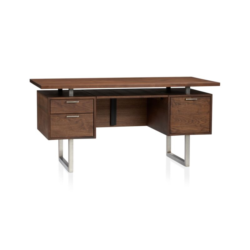 Handcrafted by a small Wisconsin woodworking company, the solid American walnut top floats on brushed stainless steel supports—a signature design element—with a functional, integrated slide-out shelf below. <NEWTAG/><ul><li>Designed by Blake Tovin of Tovin Design</li><li>Solid American walnut, walnut veneer and engineered wood</li><li>Naturally expands and contracts with changes in humidity</li><li>Dark Danish oil finish with satin wax topcoat</li><li>Stainless steel sled legs and desktop supports</li><li>Slide-out laptop/keyboard shelf</li><li>Filing drawer</li><li>Extension ball-bearing drawer glides</li><li>Brushed aluminum hardware</li><li>Cord management cutout</li><li>Made in USA</li></ul><br />