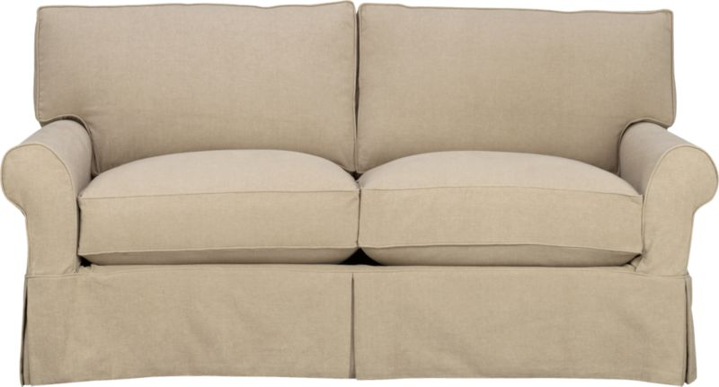 "Machine-washable skirted slipcover tailored for the Cortland Apartment Sofa takes on everyday living.<br /><br />Additional <a href=""http://crateandbarrel.custhelp.com/cgi-bin/crateandbarrel.cfg/php/enduser/crate_answer.php?popup=-1&p_faqid=125&p_sid=DMUxFvPi"">slipcovers</a> available below and through stores featuring our Furniture Collection.<br /><br />After you place your order, we will send a fabric swatch via next day air for your final approval. We will contact you to verify both your receipt and approval of the fabric swatch before finalizing your order.<br /><br /><NEWTAG/><ul><li>100% prewashed cotton slipcover</li><li>Machine washable</li></ul>"