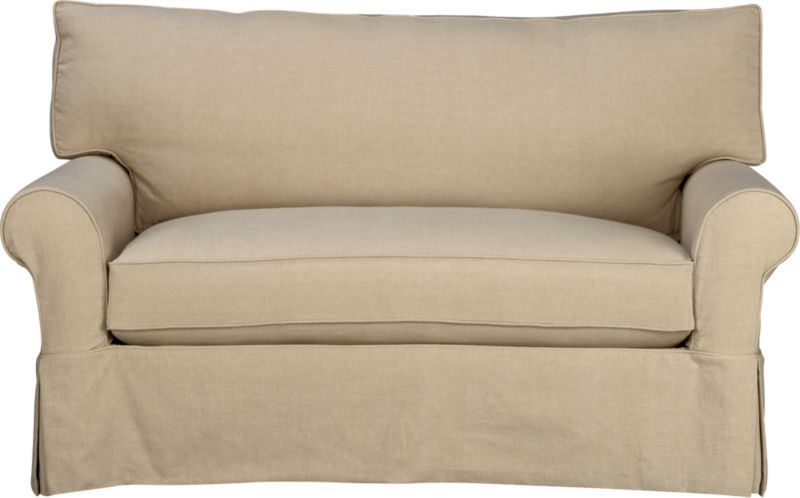 "Machine-washable skirted slipcover tailored for the Cortland Twin Sleeper Sofa takes on everyday living.<br /><br />Additional <a href=""http://crateandbarrel.custhelp.com/cgi-bin/crateandbarrel.cfg/php/enduser/crate_answer.php?popup=-1&p_faqid=125&p_sid=DMUxFvPi"">slipcovers</a> available below and through stores featuring our Furniture Collection.<br /><br />After you place your order, we will send a fabric swatch via next day air for your final approval. We will contact you to verify both your receipt and approval of the fabric swatch before finalizing your order.<br /><br /><NEWTAG/><ul><li>100% prewashed cotton slipcover</li><li>Machine washable</li></ul>"
