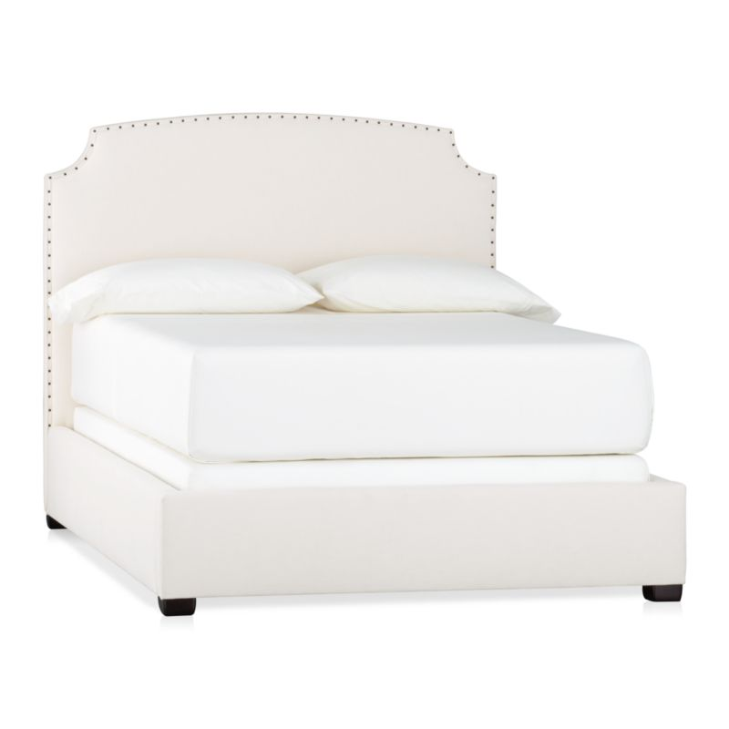 This alluring new shape stays ahead of the curve with clean contours and contemporary styling. Wrapped in a soft neutral cotton/poly blend fabric, graceful corner arcs carve an element of drama into the sleek profile. A delicate row of antiqued brass nailheads accentuate every curve, adding a subtle sweep of glamour. Mattresses and foundations available (sold separately).<br /><br />After you place your order, we will send a fabric swatch via next day air for your final approval. We will contact you to verify both your receipt and approval of the fabric swatch before finalizing your order.<br /><br /><NEWTAG/><ul><li>Certified sustainable kiln-dried hardwood frame</li><li>Soy-based foam cushioning</li><li>Cotton-poly blend fabric</li><li>Solid maple legs have an espresso finish</li><li>Slat system with support legs</li><li>Accommodates a mattress and foundation</li><li>Made in North Carolina, USA</li></ul>