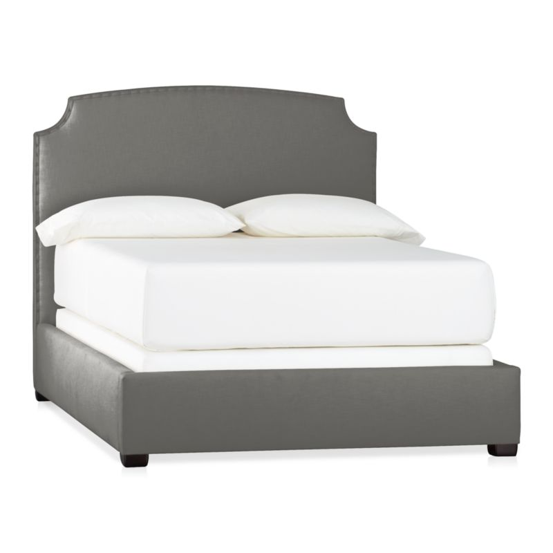 This alluring new shape stays ahead of the curve with clean contours and contemporary styling. Wrapped in a soft neutral cotton/poly blend fabric, graceful corner arcs carve an element of drama into the sleek profile. A delicate row of antiqued brass nailheads accentuate every curve, adding a subtle sweep of glamour. Mattresses and foundations available (sold separately).<br /><br />After you place your order, we will send a fabric swatch via next day air for your final approval. We will contact you to verify both your receipt and approval of the fabric swatch before finalizing your order.<br /><br /><NEWTAG/><ul><li>Certified sustainable kiln-dried hardwood frame</li><li>Soy-based foam cushioning</li><li>Cotton-poly blend fabric</li><li>Solid maple legs have an espre