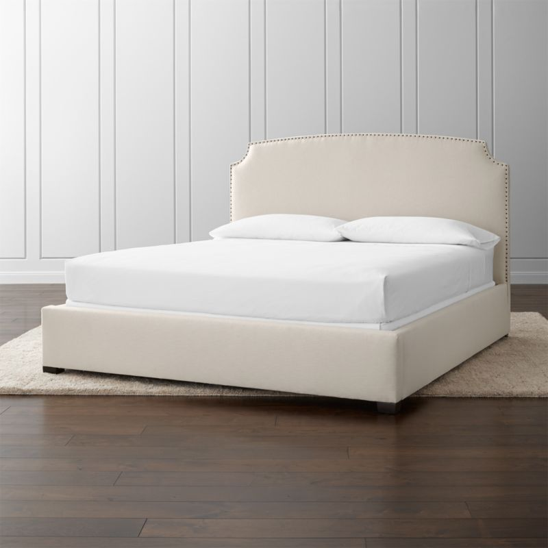 With its clean, classic styling, alluring curves and graceful corner arcs, the Curve king bed features lines that carve an element of drama into its sleek profile. <NEWTAG/><ul><li>Frame is benchmade in the USA with certified sustainable hardwood that's kiln-dried to prevent warping</li><li>Soy-based polyfoam cushioning</li><li>Solid maple legs have an brown finish</li><li>3 metal slats with 3 center support legs</li><li>Accommodates mattress and box spring (sold separately)</li><li>Maximum weight capacity: 800 lbs. (includes weight of mattress, box spring and occupants)</li><li>Material origin: see swatch</li><li>Made in North Carolina, USA</li></ul>