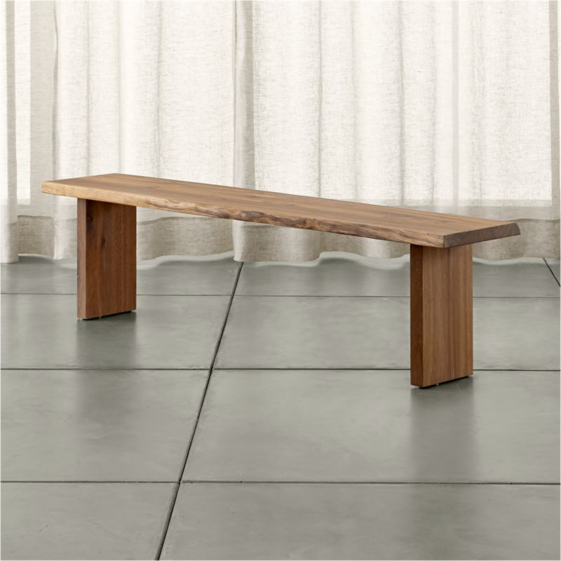 "Dakota's dramatic sweep of European white oak pales in modern shades of grey, setting an organic, elegantly understated tone for the dining room. Undulating, soft curves sanded smooth follow the tree's profile, exposing natural wood tones. <NEWTAG/><ul><li>Solid European white oak with fumed finish</li><li>Plastic floor glides</li><li>Seats three</li><li>Sized for our Dakota 99"" Dining Table</li><li>Made in Poland</li></ul>"