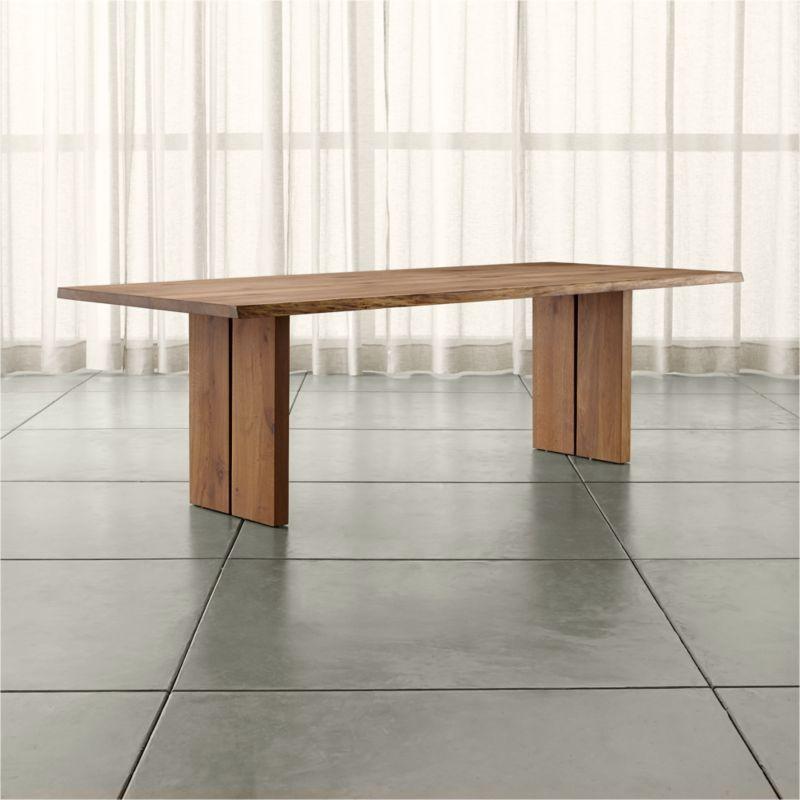 Dakota's dramatic sweep of European white oak pales in modern shades of grey, setting an organic, elegantly understated tone for the dining room. Undulating, soft curves sanded smooth follow the tree's profile, exposing natural wood tones. <NEWTAG/><ul><li>Solid European white oak with fumed finish</li><li>Plastic floor glides</li><li>Seats eight</li><li>Made in Poland</li></ul>