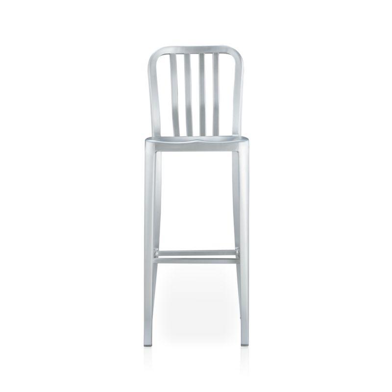 "A sleek anodized finish on aluminum makes for a polished perch with contoured back and seat.<br /><br /><NEWTAG/><ul><li>Anodized aluminum</li><li>Sculpted seat</li><li>Curved back with vertical rungs</li><li>Footrest</li><li>30""H seat sized for bars</li><li>Made in China</li></ul>"