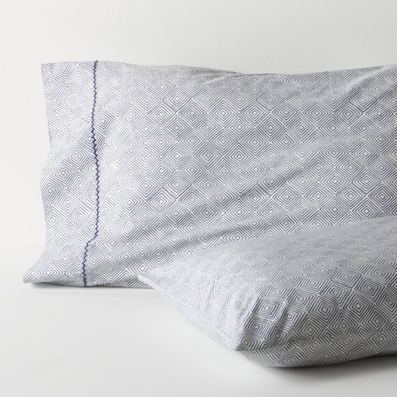 A subtle optic of concentric diamonds is screen-printed navy on neutral to layer with patterned or solid bedding. Cases are embellished with a single row of hand-embroidered chain stitching. Bed pillows also available.<br /><br /><NEWTAG/><ul><li>100% cotton percale</li><li>200-thread-count</li><li>Machine wash, tumble dry low, warm iron as needed</li><li>Made in India</li></ul>