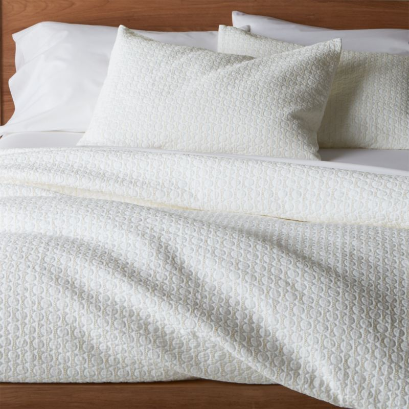 Jacquard-woven dots pepper classically elegant white coverlet with subtle texture and a hint of yellow.<br /><br /><NEWTAG/><ul><li>96% cotton and 4% polypropylene</li><li>Machine wash cold, tumble dry low; warm iron as needed</li><li>Made in Portugal</li></ul>