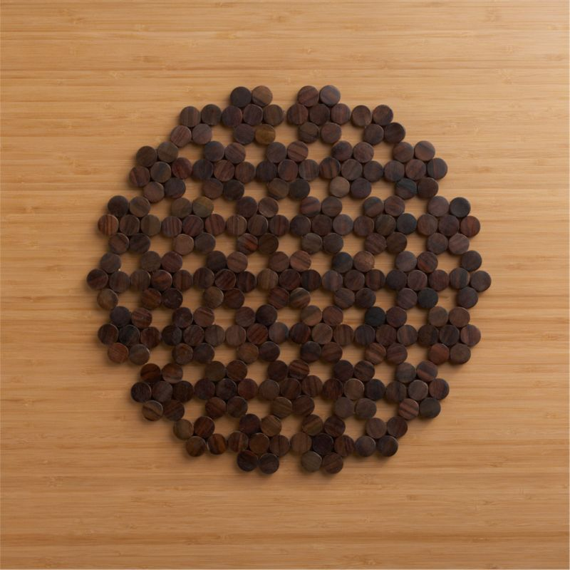 Clusters of wood chips form a wooden round that's like no doily you've ever seen.<br /><br /><NEWTAG/><ul><li>Sonokeling wood placemat</li><li>Clean placemat with a damp cloth</li><li>Made in Indonesia</li></ul>