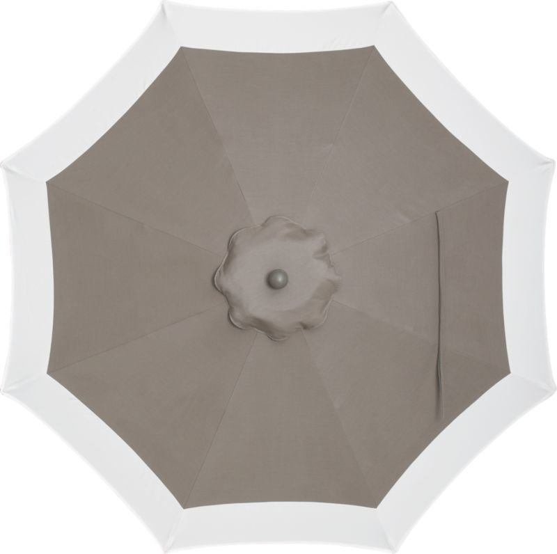 A smart canopy of neutral taupe with a wide band of natural is fade- and mildew-resistant Sunbrella® acrylic blocks out 98% of the sun's rays. Fits all of our 9' round frames. Frames and stands sold separately.<br /><br /><NEWTAG/><ul><li>Cover: fade- and mildew-resistant Sunbrella acrylic umbrella (fits all 9' round frames; spot clean)</li><li>Frames (sold separately): or aluminum tilt with bronze or charcoal finish</li><li>Made in Mexico</li></ul><br />