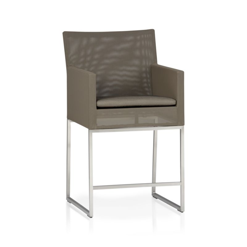 "Our urban style Dune collection is truly a modern ""indoor room"" that lives outdoors. Sleek outdoor-grade stainless steel frames are upholstered in taupe Batyline® synthetic mesh that is UV-, fade-, mold-, tear- and stain-resistant. Chairs include seat cushion with taupe weather-resistant Sunbrella® acrylic cover. Dune lounge collection also available.<br /><br /><NEWTAG/><ul><li>Outdoor-grade stainless steel frame upholstered in Batyline® synthetic mesh</li><li>Cushion is fade- and mildew-resistant Sunbrella® acrylic</li><li>Foam cushion fill</li><li>Spot clean the cushion cover</li><li>24""H seat sized for counters</li><li>Made in China</li></ul>"
