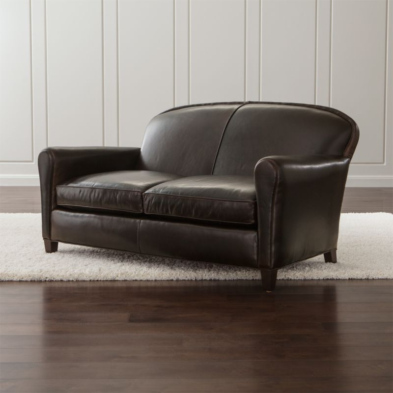 Our classic French Deco leather loveseat has all the authentic provenance of the originals, from its low seat to its angled back. Eiffel is the epitome of comfort with 2 seat cushions crafted with eight-way hand-tied springs that support your every move. <NEWTAG/><ul><li>Frame is benchmade in the USA with sourced hardwood that's kiln-dried to prevent warping</li><li>Soy-based polyfoam seat cushions wrapped in regenerated synthetic fiber and encased in downproof ticking</li><li>Soy-based polyfoam and synthetic fiber back cushion</li><li>Eight-way hand-tied spring suspension</li><li>Hardwood legs with a black walnut finish</li><li>Material origin: see swatch</li><li>Made in North Carolina, USA</li></ul>