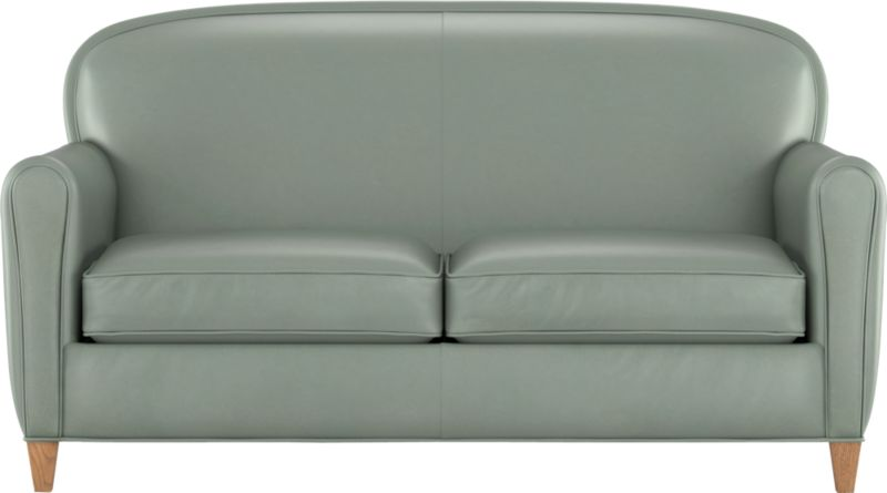 Our classic French Deco leather club loveseat has all the authentic provenance of the originals, from its low seat to its quite rakish, angled back that sits deep and encourages reading every single word on every single page of the Sunday Times. A handsome welted arc at the top and slightly rounded arms are very much of the period. Oak legs finished in weathered grey are the perfect complement.<br /><br />After you place your order, we will send a leather swatch via next day air for your final approval. We will contact you to verify both your receipt and approval of the leather swatch before finalizing your order.<br /><br /><NEWTAG/><ul><li>Eco-friendly construction</li><li>US-sourced kiln dried hardwood</li><li>Seat cushions are soy-based polyfoam wrapped in regenerated synthetic fiber and encased in downproof ticking</li><li>Tight back is filled with soy-based polyfoam an