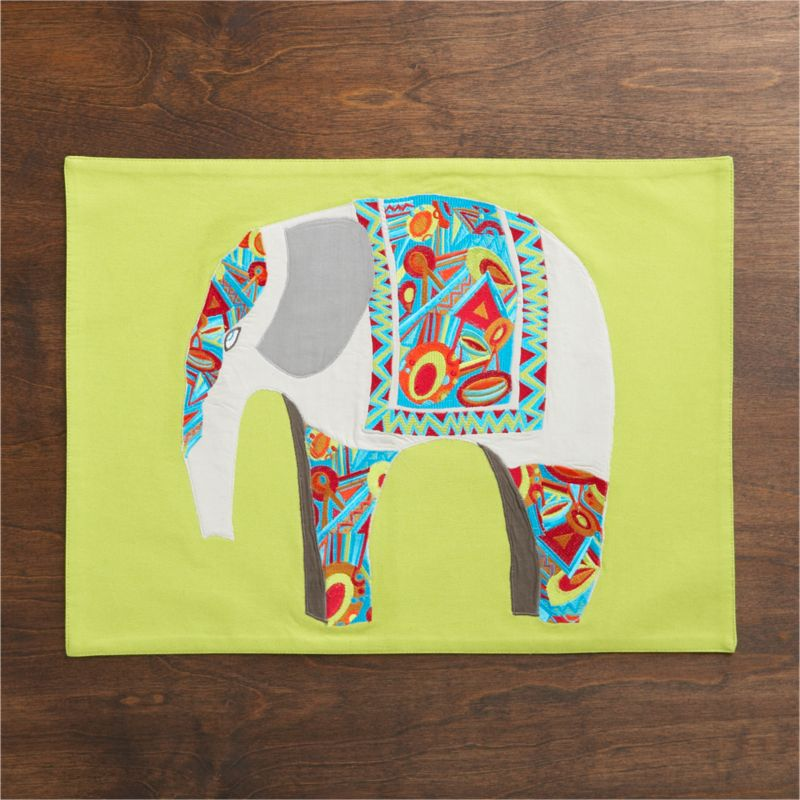 The elephant in the room is on a lime green placemat, whimsically embellished with sprightly colored and intricately embroidered patterns, inspired by traditional Indian designs.<br /><br /><NEWTAG/><ul><li>100% cotton base</li><li>100% rayon embroidery</li><li>Dry clean only</li><li>Made in India</li></ul>