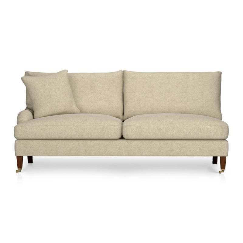 A most proper English-style sofa influences and a most unstuffy, unexpected living room manner. The experience is as sink-in-comfortable as it looks with deep cushions tailor-finished in a slubby linen blend with top-stitch detailing. Elegantly tapered front legs with black walnut stain.<br /><br />After you place your order, we will send a fabric swatch via next day air for your final approval. We will contact you to verify both your receipt and approval of the fabric swatch before finalizing your order.<br /><br /><NEWTAG/><ul><li>Eco-friendly construction</li><li>Certified sustainable, kiln-dried hardwood frame</li><li>Seat cushions are multilayer soy-based foam surrounded by a down-fiber blend encased in downproof ticking</li><li>Back cushions are filled with a down-fiber blend encased in downproof ticking</li