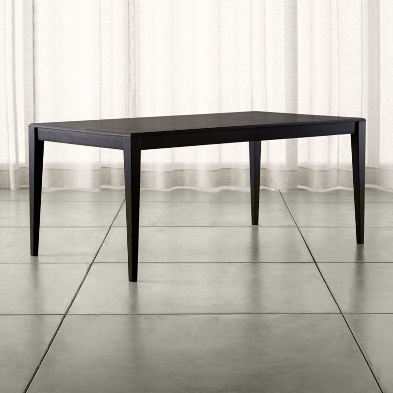"""Contemporary lines with beveled edging suits the versatile attitude of Facet, an affordable extension table that effortlessly adapts from casual to more formal living spaces. <NEWTAG/><ul><li>Designed by Mark Daniel of Slate</li><li>Five-ply oak veneer top</li><li>Black stain and low-sheen lacquer finish</li><li>Dowel joinery reinforced with glue and screws</li><li>Solid rubberwood apron and legs with adjustable levelers</li><li>Rubberwood glides</li><li>Seats six; eight with 22"""" leaf</li><li>Made in Vietnam</li></ul><br />"""