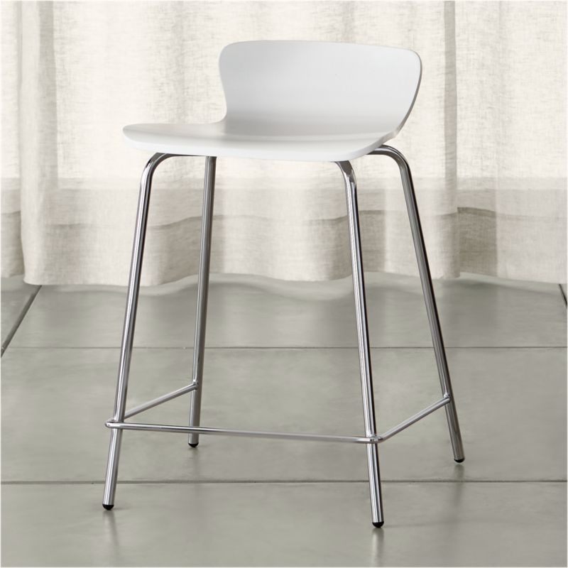 For casual entertaining at a counter or high dining table, we suggest this classic bent plywood stool that offers an affordable, versatile mix-and-match option. Designed by Mark Daniel of Slate with a retro modern low-profile back curving into a generous seat, the counter stool's crisp white finish is supported by stable, chrome-plated metal legs that complement the style. The Felix White Counter Stool is a Crate and Barrel exclusive.<br /><br /><NEWTAG/><ul><li>Designed by Mark Daniel of Slate</li><li>Birch bent plywood and basswood veneer</li><li>White painted finish with polyurethane topcoat</li><li>Chrome tube legs</li><li>Made in China</li></ul>