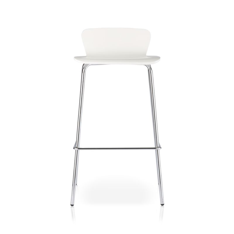 Offering the opportunity to mix and match at a value, the Felix bar stool is the perfect perch for elevated casual entertaining. This classic bent plywood bar stool is designed by Mark Daniel of Slate with a retro modern low-profile back curving into a generous seat with a crisp white finish. Chrome-plated metal legs complement while providing ultimate stability. The Felix White Bar Stool is a Crate and Barrel exclusive.<br /><br /><NEWTAG/><ul><li>Designed by Mark Daniel of Slate</li><li>Birch bent plywood and basswood veneer</li><li>White painted finish with polyurethane topcoat</li><li>Chrome tube legs</li><li>Made in China</li></ul><br />