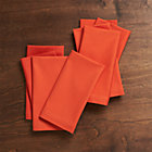 Set of eight Fete Tangelo Cotton Napkins.