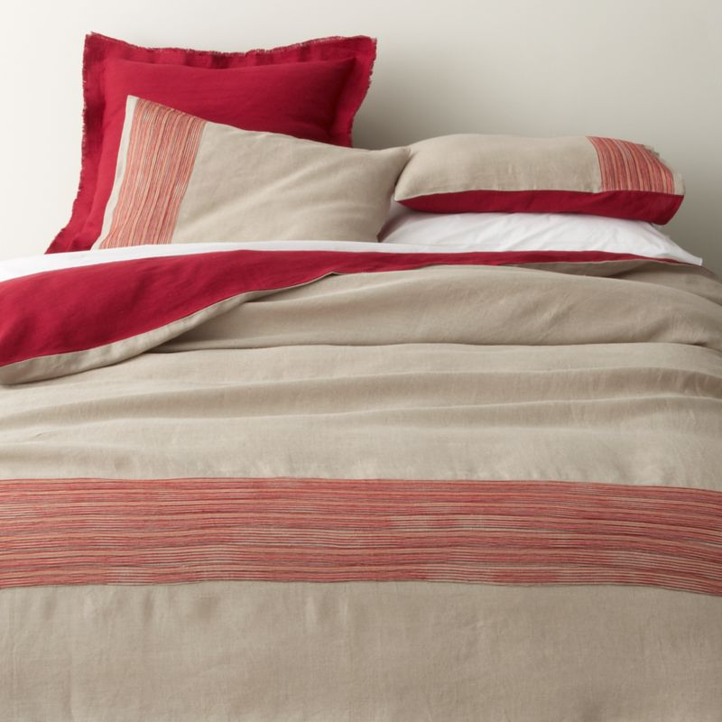 Fiery red lights up natural linen bedding with embroidered tonal bands and deep solid accents. Off-center detailing wraps the foot of the bed in colorful stripes, reversing to solid red. Duvet covers have interior ties to hold insert in place and hidden-zipper closure. Duvet inserts also available.<br /><br /><NEWTAG/><ul><li>100% linen</li><li>100% polyester embroidery</li><li>Machine wash, tumble dry low; iron damp</li><li>Made in India</li></ul>