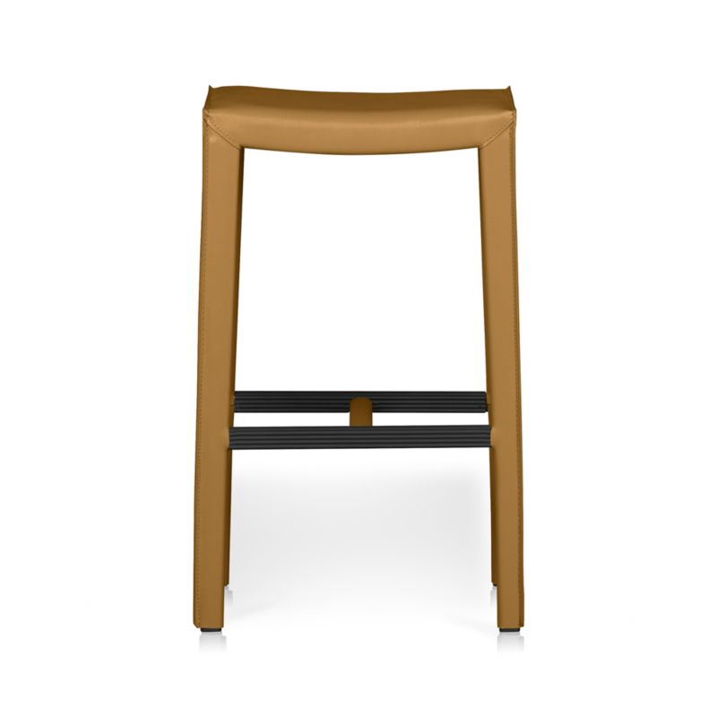 In a reinterpretation of classic Italian design with clean Parsons-inspired lines, our convivial Folio leather backless bar stool is also designed with comfort in mind, from the inviting foam-cushioned seat to the handy footrest with protective cover. <NEWTAG/><ul><li>Welded steel frame</li><li>Polyfoam seat cushion with fiber wrap</li><li>Mitered cut and stitched leather</li><li>Flange seaming</li><li>Grooved footrest with protective cover</li><li>Material origin: see swatch</li><li>Made in China</li></ul>