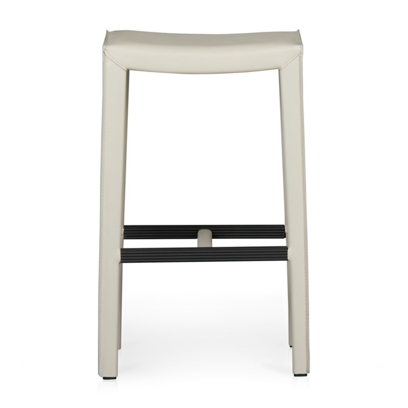 This open perch, sized especially for the bar, reinvents classic Italian design with clean Parsons-style lines and comfort and value in mind. This sleek, versatile bar stool is fully wrapped in durable bonded leather and finished with the kind of details that make it a customer favorite: neat mitered corners, flange seaming and stitching. <NEWTAG/><ul><li>Welded steel frame</li><li>Polyfoam seat cushion with fiber wrap</li><li>Mitered cut and stitched leather</li><li>Flange seaming</li><li>Grooved footrest</li><li>Material origin: see swatch</li><li>Made in China</li></ul>