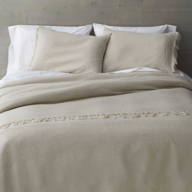 Softly textured pintuck pleats and relaxed fringe embellish the casual luxury of natural linen bedding. Pleasant to the touch, natural linen fiber cools in summer and warms in the winter and becomes softer and more lustrous with each wash. Reversible duvet cover has a zipper closure and interior fabric ties to hold the insert in place. Duvet inserts and bed pillows also available.<br /><br /><NEWTAG/><ul><li>100% linen</li><li>Machine wash cold, tumble dry low; iron damp</li><li>Made in India</li></ul>