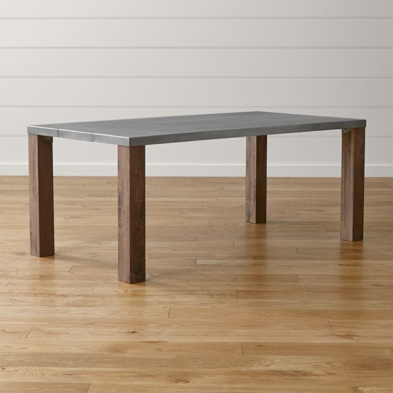 An artisanal pairing of wood and metal, Galvin offers an industrial look that still reads warm and clean. A zinc-treated top—crafted from lengths of steel mimicking traditional wood planks—rests on solid mango legs with visible grain. <NEWTAG/><ul><li>Milled steel top hot-dipped in zinc with clear matte powdercoat finish</li><li>Solid mango wood legs with acrylic-based lacquer coat, hand finished with a rubbed wash wax finish</li><li>Naturally occurring grains and knots</li><li>Seats eight</li><li>Made in India</li></ul>