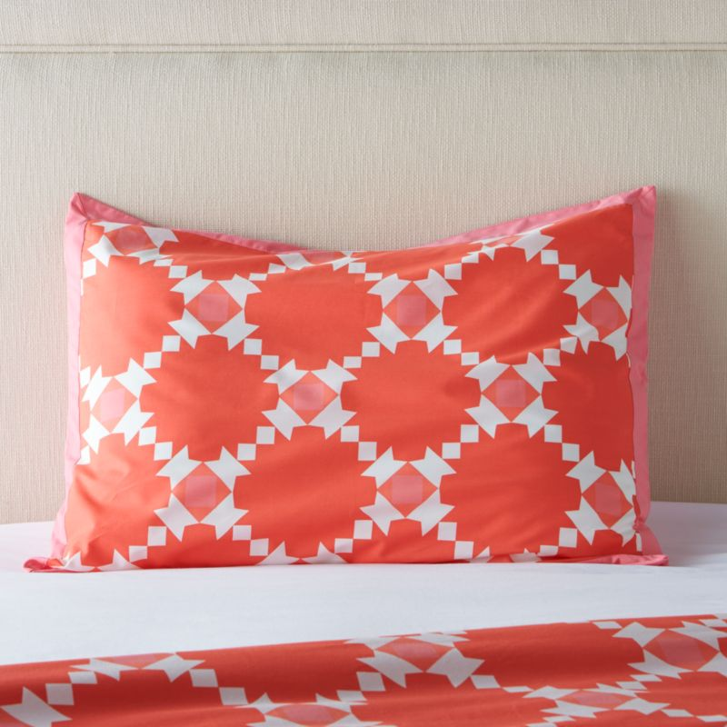 Classic geometric quilting pattern updates in sunny coral and white as a sunny, streamlined graphic by London designer Genevieve Bennett, printed on soft cotton percale. Bold pattern pairs beautifully with scaled-down motif of coordinating Genevieve bed sheets. Bed pillows also available.<br /><br /><NEWTAG/><ul><li>Designed by Genevieve Bennett</li><li>100% cotton percale</li><li>200-thread-count</li><li>Overlapping back closures</li><li>Machine wash cold, tumble dry low; warm iron as needed</li><li>Made in Portugal</li></ul>
