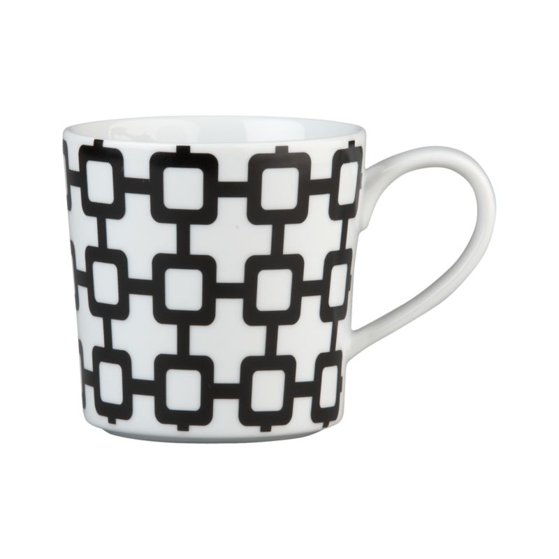 Bold design on a contemporary white porcelain mug adds a graphic punch at coffee time.<br /><br /><NEWTAG/><ul><li>Porcelain</li><li>Dishwasher-, microwave-, freezer- and oven-safe to 395 degrees</li><li>Made in China</li></ul>