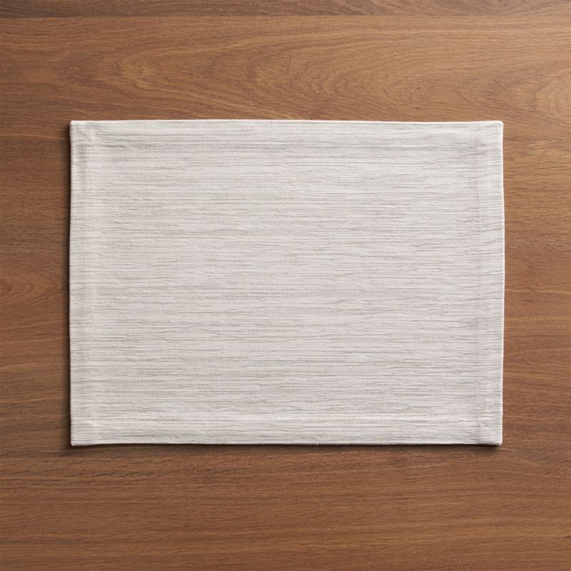 Rich hand-dyed colors in subtle tone-on-tone hues are hand-dyed and -woven into a grasscloth-textured placemat.<br /><br /><NEWTAG/><ul><li>Handcrafted</li><li>98% cotton and 2% fiber</li><li>Oversized to allow for shrinkage</li><li>Machine wash warm, dry flat; iron as needed</li><li>Made in India</li></ul>