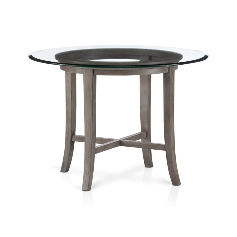 "Halo's simple beauty lies in its open presentation of materials, construction and design. Constructed with precision, requiring no screws or nails, the solid chestnut wood base features slightly flared legs that extend from the apron and a cross brace to support a floating clear rounded glass top. <NEWTAG/><ul><li>Designed by Maria Yee</li><li>Solid chestnut base with grey-washed lacquer finish</li><li>Clear ½""-thick glass top with reverse bevel and polished edge</li><li>BreathingJoinery ™</li><li>Plastic glides</li><li>Seats four</li><li>Made in China</li></ul>"