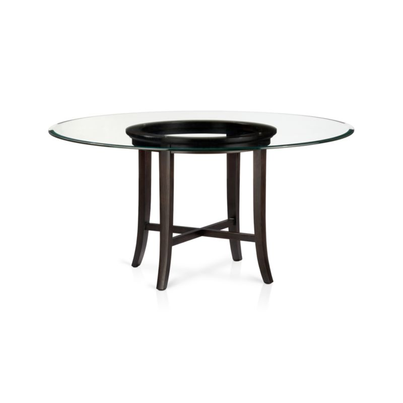 """With its distinctive """"halo"""" effect, this striking dining table designed by Maria Yee features a flat glass top with a deep light-refracting reverse bevel supported by a solid chestnut wood base with cross brace and slightly flared legs that extend from the apron. The halo is echoed in the open ring top of the frame, finished with a rich, deep ebony stain. <NEWTAG/><ul><li>Designed by Maria Yee</li><li>Solid chestnut base with deep ebony finish</li><li>Clear ½""""-thick glass top with reverse bevel and polished edge</li><li>BreathingJoinery ™</li><li>Plastic glides</li><li>Seats 6</li><li>Made in China</li></ul>"""