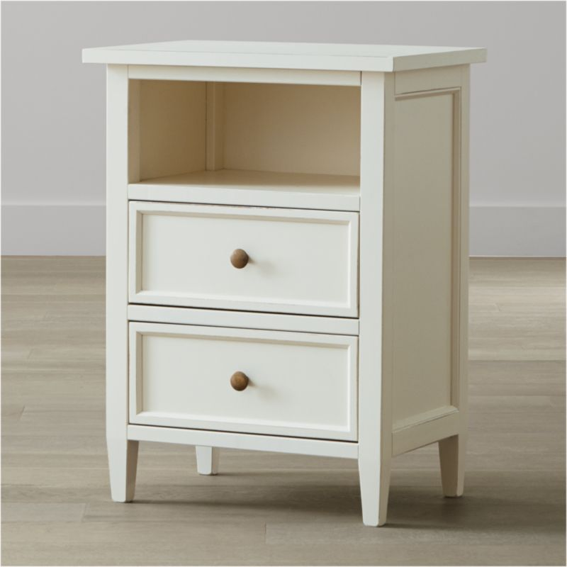 Our casual-modern bedroom collection evokes the simple pleasures of days at the shore. Handpainted in soft white and distressed with a warm patina by Italian master craftsmen, the Harbor nightstand has 2 drawers with contrasting sage green interiors and antique brass knobs and a convenient open storage area. <NEWTAG/><ul><li>Solid Tulip wood and Tanganyika walnut veneer over engineered wood</li><li>Hand-applied white water-based paint sealed with a beeswax finish</li><li>Naturally expands and contracts with changes in humidity</li><li>Contrasting sage green finish inside drawers</li><li>Wood on wood drawer glides</li><li>Antique brass knobs</li><li>Made in Italy</li></ul>
