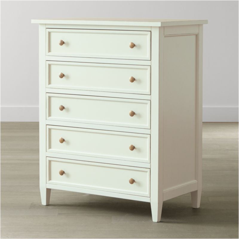 Handpainted in soft white and distressed with a warm patina by Italian master craftsmen, our casual-modern Harbor bedroom collection evokes the simple pleasures of days at the shore. The 5-drawer chest's simple lines are accented by antique brass knobs, with sage green drawer interiors surprising in charming contrast. <NEWTAG/><ul><li>Solid Tulip wood and Tanganyika walnut veneer over engineered wood</li><li>Hand-applied white water-based paint sealed with a beeswax finish</li><li>Naturally expands and contracts with changes in humidity</li><li>Contrasting sage green finish inside drawers</li><li>Wood on wood drawer glides</li><li>Antique brass knobs</li><li>Made in Italy</li></ul>